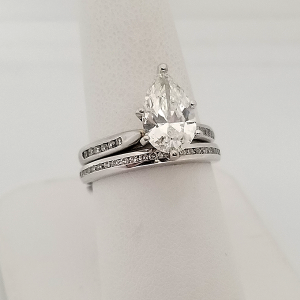 Pear diamond teardrop shaped solitaire with Diamond Accents