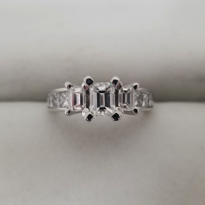 Emerald cut center 3 stone past present future engagement ring