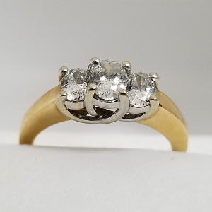 Past Present Future 3 stone oval engagement ring