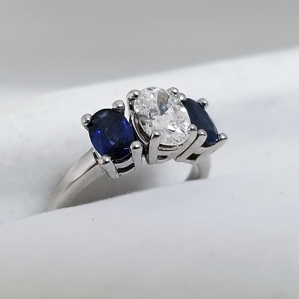 Diamond Oval Center with Oval Sapphires on the side