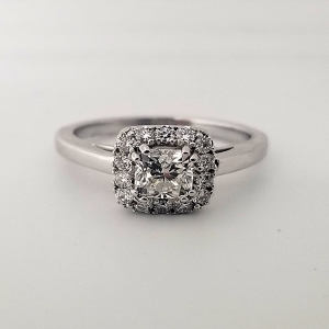 Cushion shaped engagement ring halo diamond accents