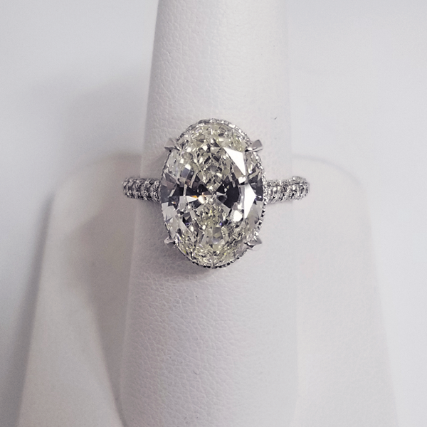 oval solitaire with diamond accent on the band