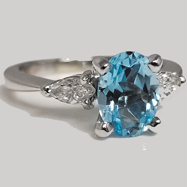 Oval Blue Topaz Center with Diamonds Accent Side Stones and white gold band