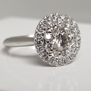 Cluster center engagement ring round halo