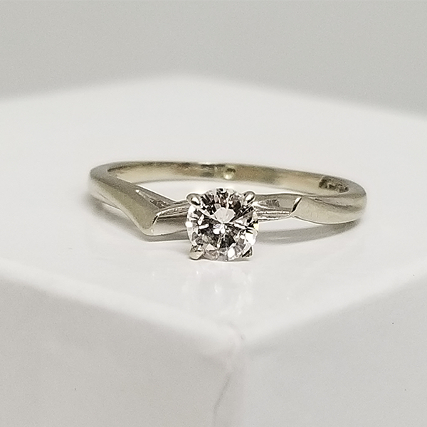Funky Solitaire in White Gold with Round Diamond Center