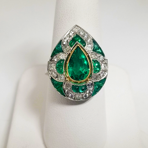 true vintage pear shaped engagement ring emeralds