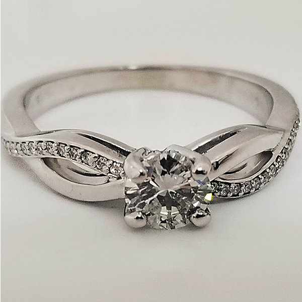 Solitaire With Twisted Infinity Band & Diamond Accents