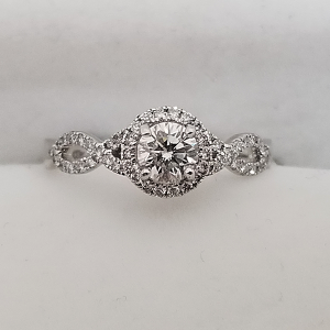dainty halo engagement ring with infinity band