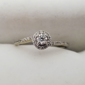 Daint halo engagement ring with bypass band