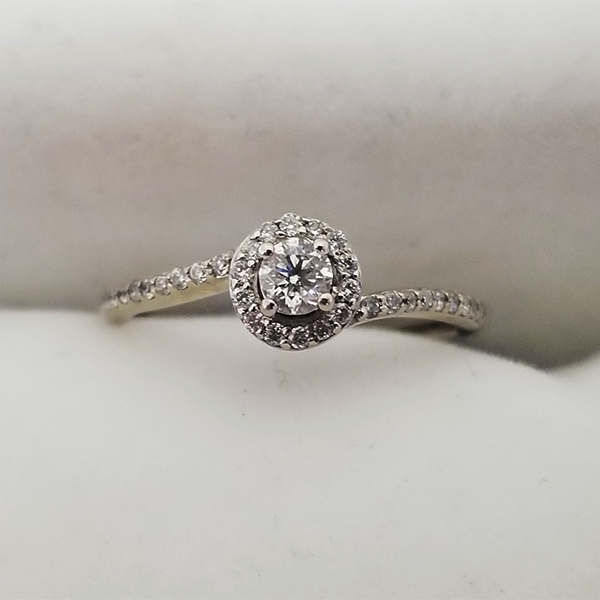 Dainty halo engagement ring with bypass band