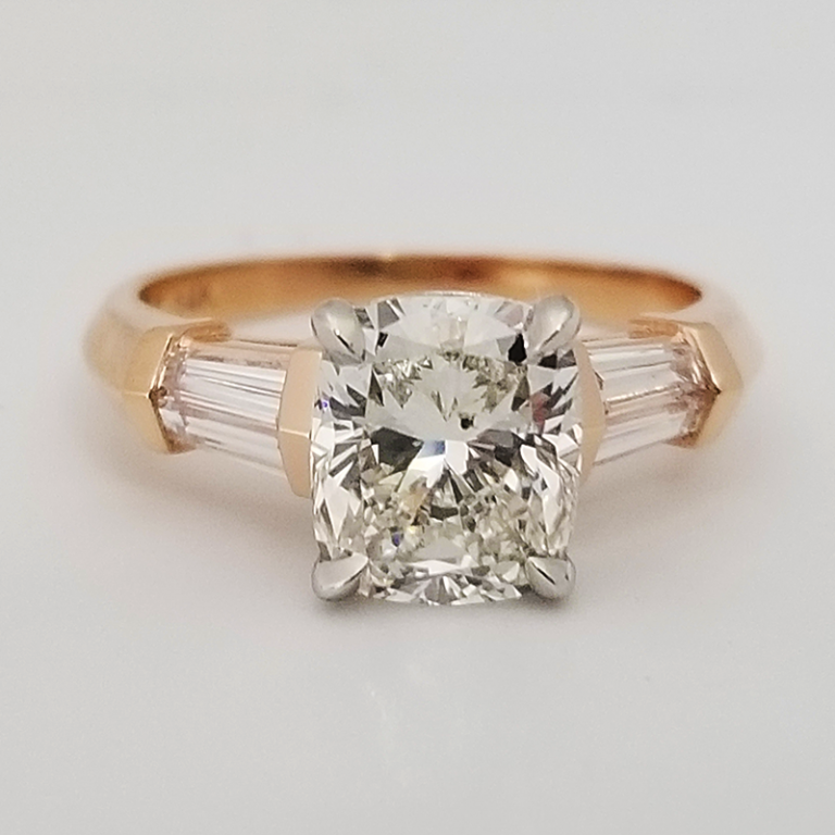 Cushion cut engagement ring with baguette accent diamonds in rose gold