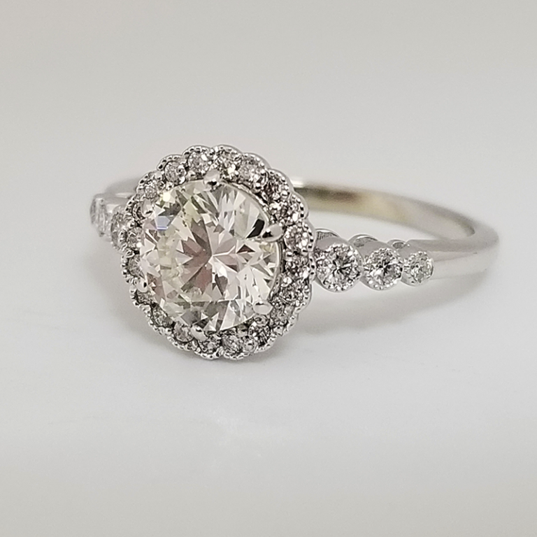 Round vintage halo ring in white gold