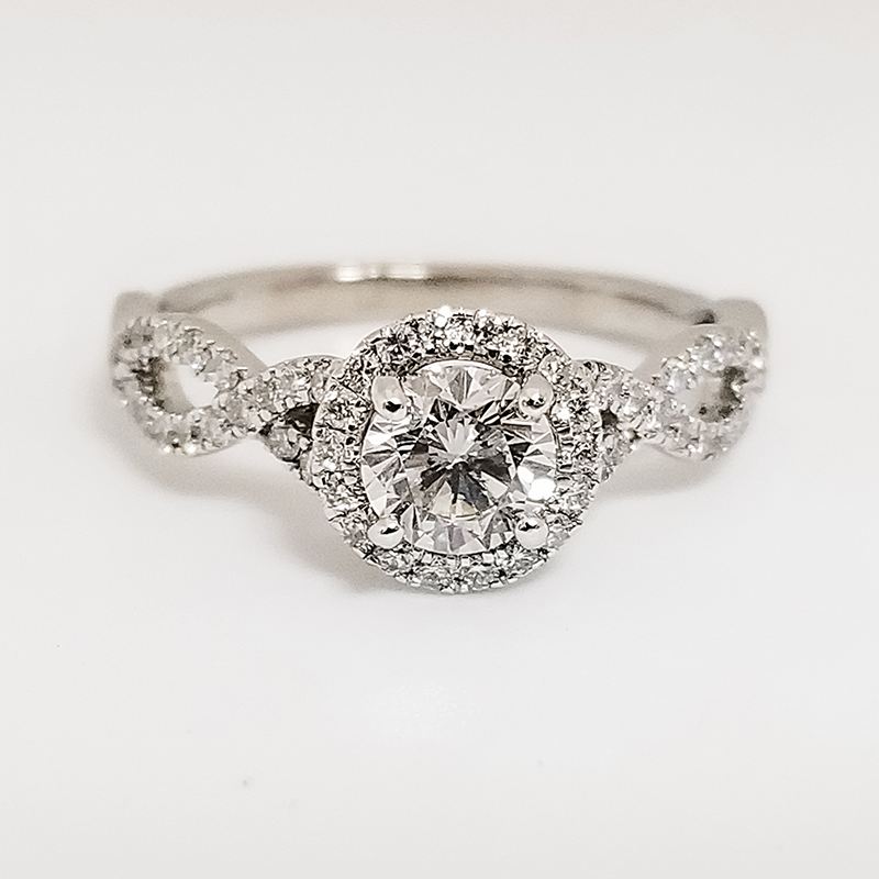 white gold round cut diamond halo engagement ring with infinity style band