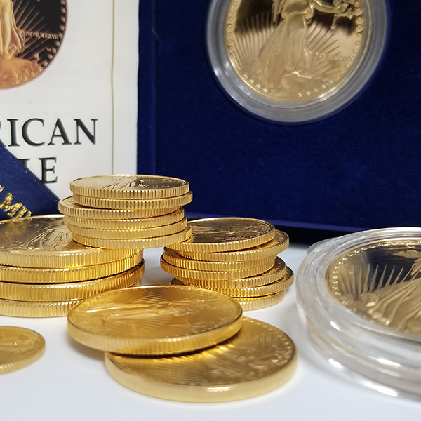 A collection of coins ready for inspection from our gold buyer near Tempe, AZ