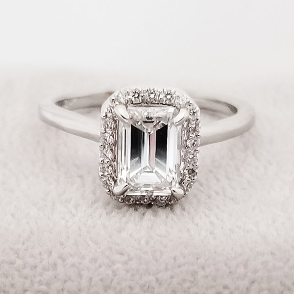 halo engagement ring with 1ct emerald cut center