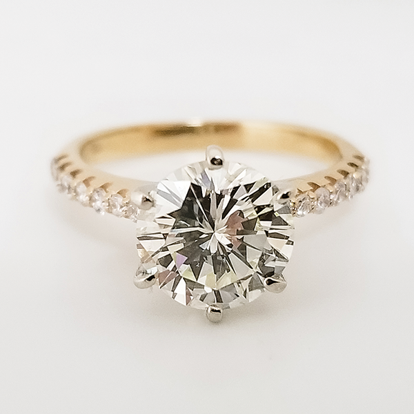 Yellow gold round solitaire engagement ring near Tempe, AZ