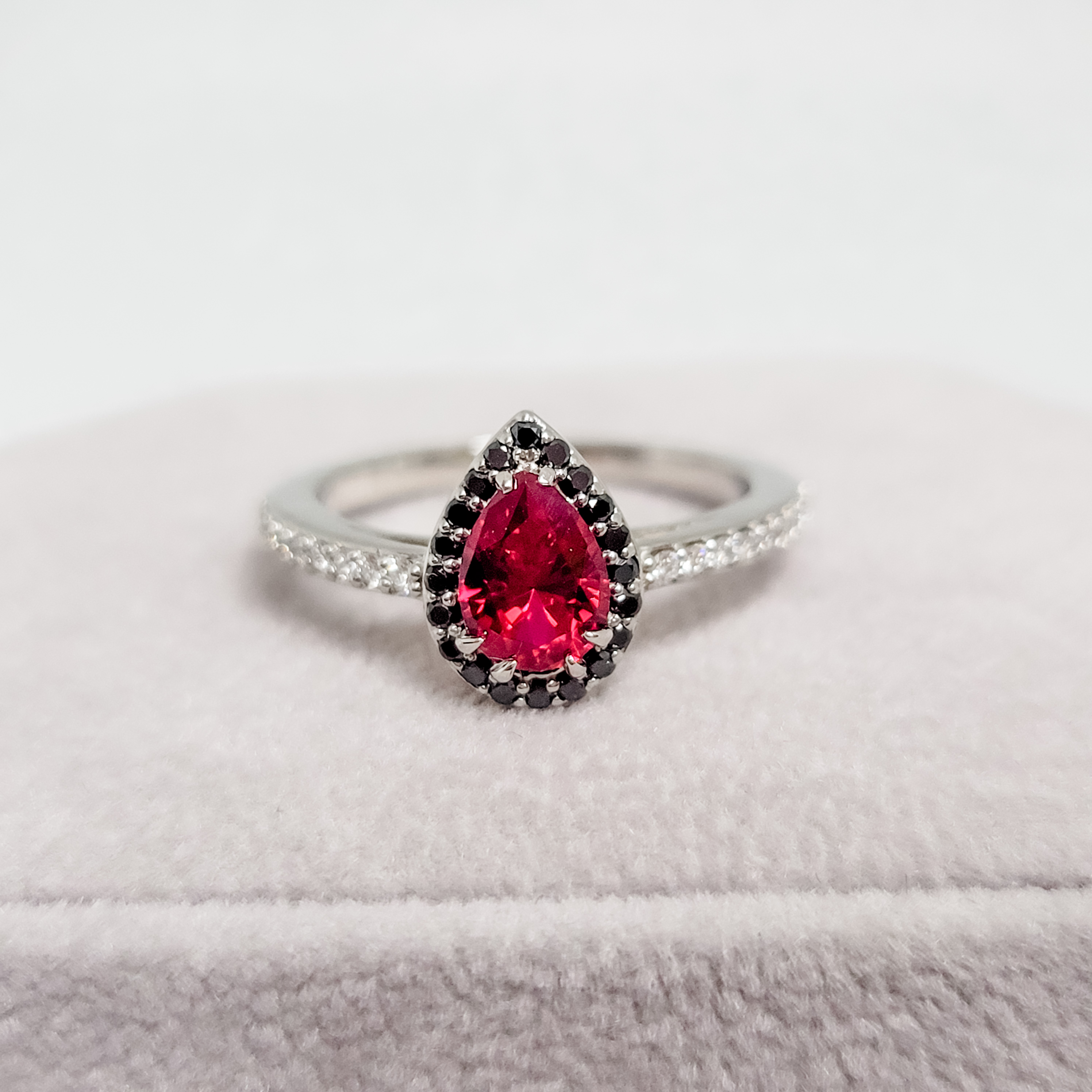 Red Pear Shaped Stone in Halo Engagement Ring