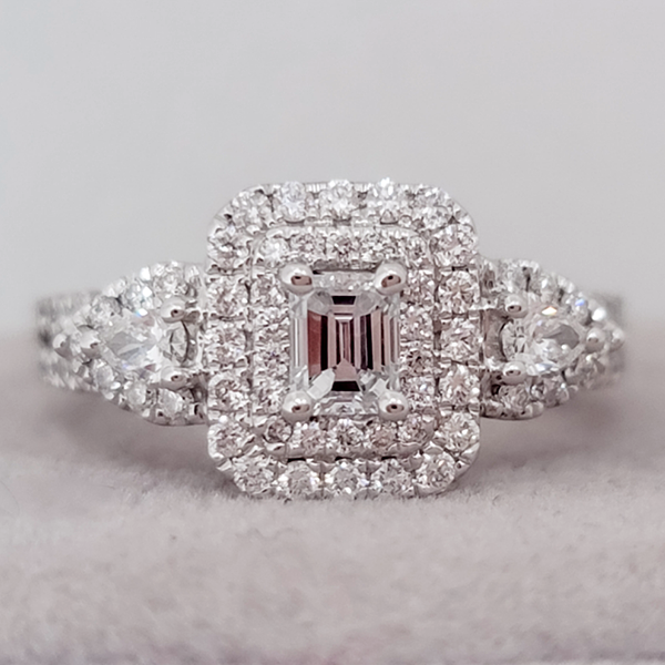 emerald cut diamond in a double halo with side accent stones